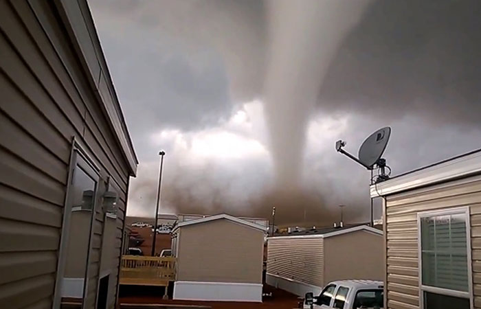 This Monday, May 26, 2014 photo from video provided by Dan Yorgason, shows a tornado in a worker's camp near Watford City, N.D., in the heart of the state's booming oil patch. The tornado injured nine people, including a 15-year-old girl who suffered critical injuries, and damaged or destroyed more than a dozen trailers at the camp. (AP Photo/Dan Yorgason)