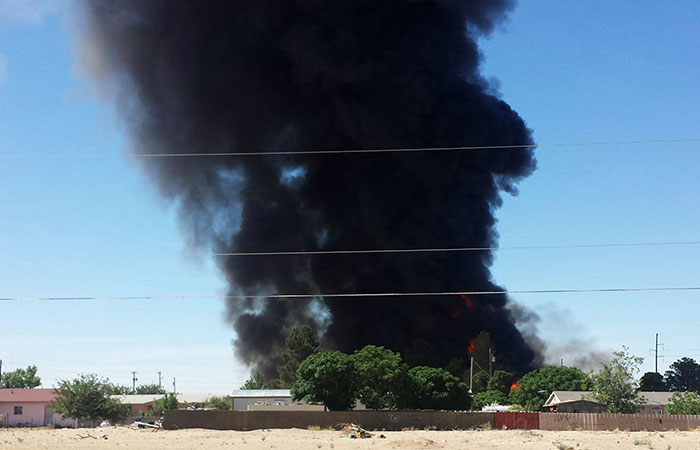 Smoke rises from a fire at Rio Valley Biofuels near Anthony, New Mexico, on Tuesday. The area was evacuated because of the threat of the blasts from methanol on the premises, according to authorities. Other chemicals included vegetable oil, hydrochloric acid and bio-diesel fuel. (Miguel Favela/Associated Press)