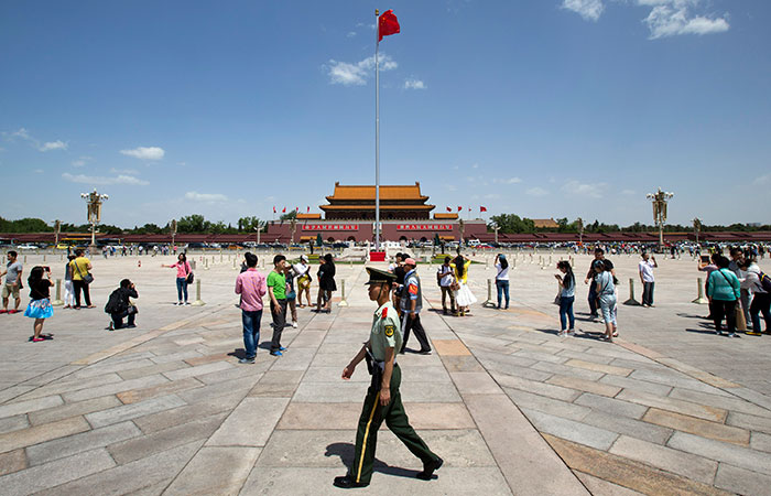 A paramilitary policeman patrols Tiananmen Square in Beijing, China, on Tuesday. (Alexander F. Yuan/The Associated Press)