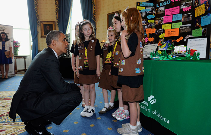 """President Barack Obama talks with a group of girl scouts from Tulsa, Okla., who designed a  """"flood-proof"""" bridge as he tours the 2014 White House Science Fair exhibits that are on display in the State Dining Room of the White House in Washington, Tuesday, May 27, 2014. Obama was celebrating the student winners of a broad range of science, technology, engineering and math (STEM) competitions from across the country. (AP Photo/Susan Walsh)"""