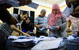 Election workers count ballots at a center in Cairo on Wednesday, May 28. With nearly all votes counted, Egypt's former military chief Abdel-Fattah el-Sissi won over his opponent with more than 92 percent of the votes, according to results announced by his campaign. The campaign said he won 23.38 million votes, with left-wing politician Hamdeen Sabahi taking 735,285. (Lobna Tarek, El Shorouk Newspaper/Associated Press)
