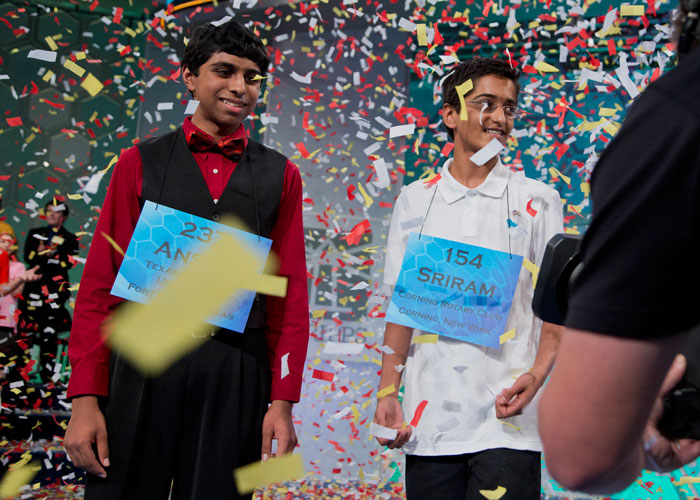 The two spelling bee champions celebrate their victory.