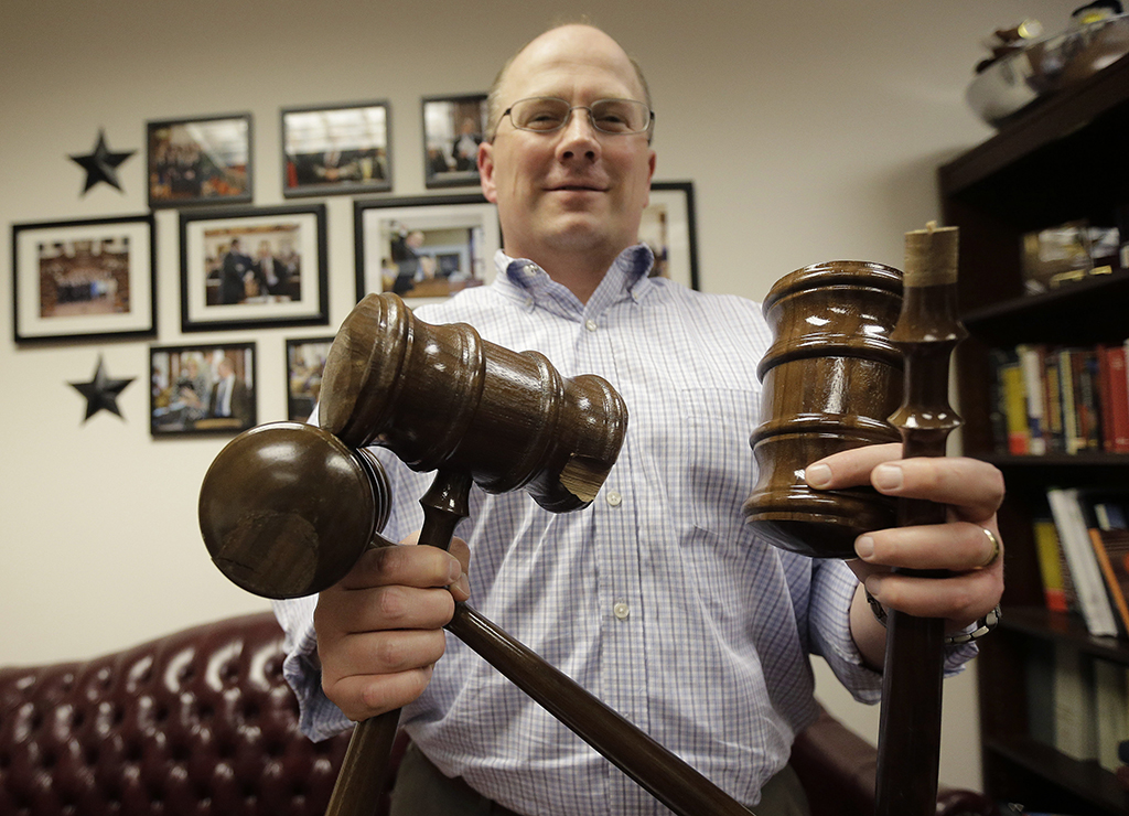 Texas Rep. Kenneth Sheets, R-Dallas, poses with three of the six solid, mahogany gavels he broke during the legislative session this year, Monday, June 1, 2015, in Austin, Texas. At 5-feet-5-inches, Sheets is one of the smallest members of the Texas Legislature, but he's broken six solid, mahogany gavels crafted by Texas prison inmates this session alone, outpacing any other lawmaker. (AP Photo/Eric Gay)