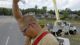 Gabe Lentz, a lineman with Entergy Arkansas, pours water over his head to cool off , in Little Rock, Ark., as temperatures reached well into the 90s in this Aug. 8, 2006 file photo. (AP Photo/Mike Wintroath)