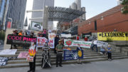 exxon mobil shareholders meeting protest