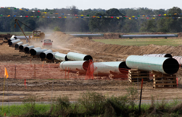 Large sections of pipe are shown in Sumner, Texas, on Oct. 4, 2012. Safety regulators added two more conditions to the construction of TransCanada Corp.'s Keystone XL oil pipeline.(Tony Gutierrez/Associated Press)