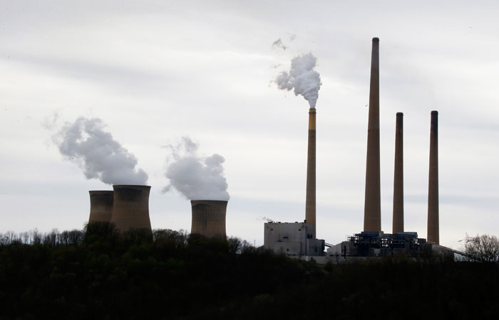 """This photo taken May 5, 2014 shows the stacks of the Homer City Generating Station in Homer City, Pa. Three years ago, the operators of one of the nation's dirtiest coal-fired power plants warned of """"immediate and devastating"""" consequences from the Obama administration's push to clean up pollution from coal. Faced with cutting sulfur dioxide pollution blowing into downwind states by 80 percent in less than a year, lawyers for EME Homer City Generation L.P. sued the Environmental Protection Agency to block the rule, saying it would cause a painful spike in electricity bills and grave harm to power producers like itself. (AP Photo/Keith Srakocic)"""