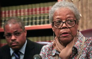 Alma Murdough, mother of marine Jerome Murdough who was found dead in a 100-degree cell on Rikers Island, speaks at a press conference on May 16, 2014 in New York. Her attorney, Derek Sells, plans to file a $25 million wrongful death lawsuit against the city. (Bebeto Matthews/Associated Press)