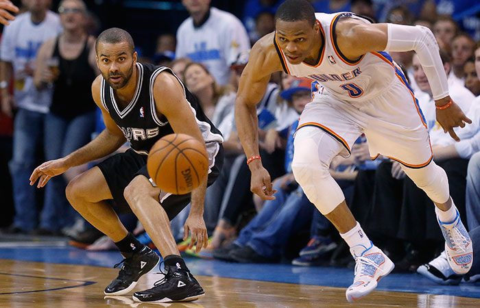 San Antonio Spurs guard Tony Parker, left, and Oklahoma City Thunder guard Russell Westbrook  watch a loose ball in  Game 4 of the Western Conference finals Tuesday in Oklahoma City. (Sue Ogrocki/The Associated Press)