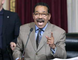 Los Angeles City Council President Herb Wesson speaks to Council members to vote to raise the minimum wage in the city to $15 an hour by 2020 in Los Angeles Wednesday, June 3, 2015. The Los Angeles City Council has voted 13-1 to raise the minimum wage to $15 an hour by 2020, but a second vote is required. The ordinance tentatively approved Wednesday had the endorsement of Mayor Eric Garcetti. A final vote will be taken June 10 because the action Wednesday was not unanimous. The increases would begin with a wage of $10.50 in July 2016, followed by annual increases to $12, $13.25, $14.25 and then $15. Small businesses and nonprofits would be a year behind. (AP Photo/Damian Dovarganes )