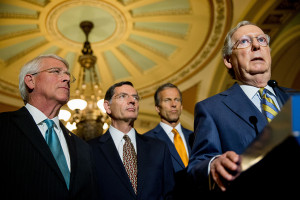 Senate Majority Leader Mitch McConnell of Ky., right, accompanied by, from left, Sen. Roger Wicker, R-Miss., Sen. John Barrasso, R-Wyo. and Sen. John Thune, R-S.D., speaks to the media during a news conference on Capitol Hill in Washington, Tuesday, June 2, 2015, following a Senate policy luncheon as legislation to end the National Security Agency's collection of Americans' calling records while preserving other surveillance authorities is expected to clear the Senate late Tuesday. But House leaders have warned their Senate counterparts not to proceed with planned changes to a House version. (AP Photo/Andrew Harnik)