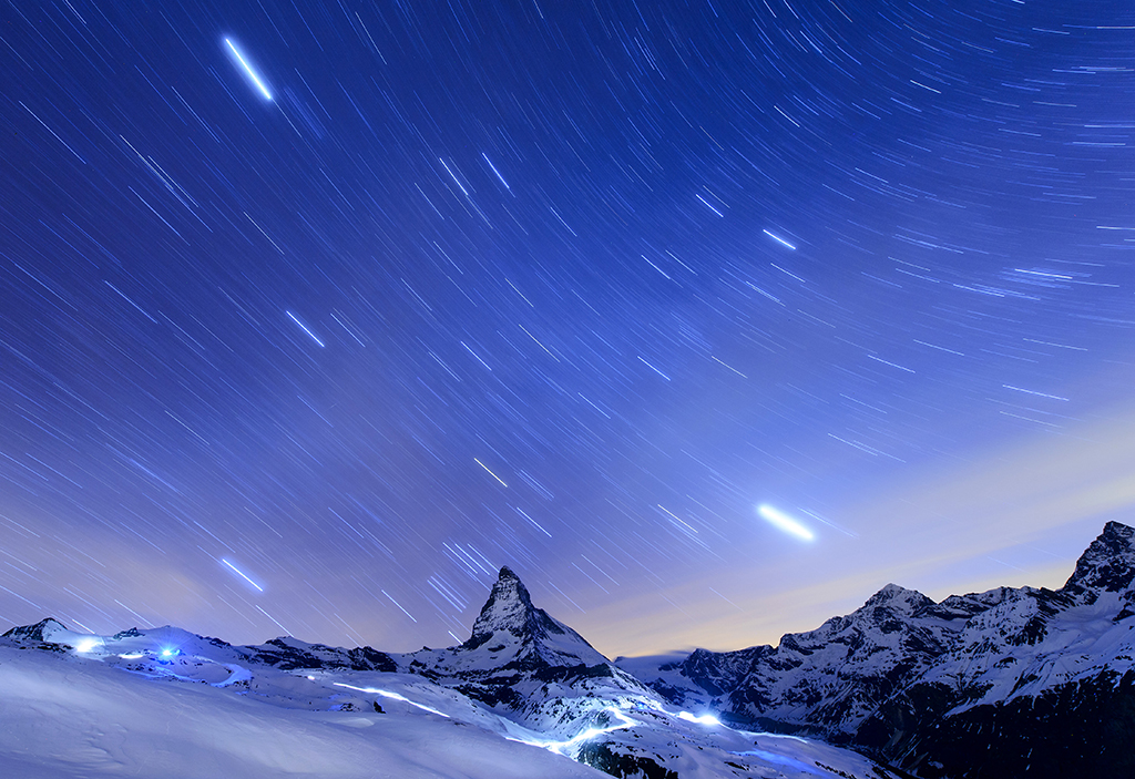 In this , April 13, 2015 file photo, taken  with a long time exposure, stars are pictured over the Matterhorn mountain, near  Zermatt, Switzerland. Switzerland's most famous mountain, will be closed to climbers on the 150th anniversary next month of the first ascent.The Alpine resort of Zermatt says the 24-hour shutdown July 14 is intended as a mark of respect to more than 500 climbers who have died on the mountain, starting with four of the seven-strong team that first reached the summit in 1865.  (Jean-Christophe Bott/Keystone via AP,File)